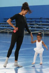 Lindsey Croop, a dancer from the School of Dance in Harlem teaches Gabriela Young, 3, ballet at a dance class in Quincy, Fla., Saturday, Dec. 8, 2018.