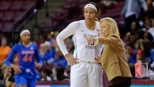 Florida State women's head coach Sue Semrau points out instructions to Kiah Gillespie versus the Florida Gators.