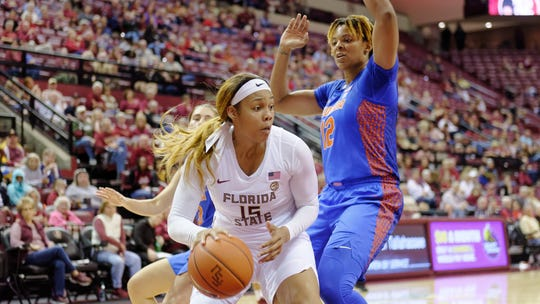 Florida State forward Kiah Gillespie drives to the hoop versus Florida's Zada Williams. Gillespie scored 19 points in FSU's 63-56 win.