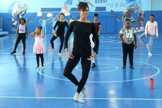 Lindsey Croop, a dancer from the School of Dance in Harlem, leads a dance class for children and teenagers in the Quincy, Fla. community attend a dance class Saturday, Dec. 8, 2018.