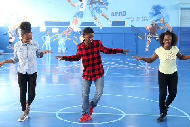 Children and teenagers from the Quincy, Fla. community attend a dance class led by Lindsey Croop, a dancer from the School of Dance in Harlem, Saturday, Dec. 8, 2018.