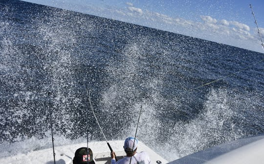 Alan Sadler of West Palm Beach, owner of the 62-foot Viking, Intents, reels in one of his team's three sailfish caught Friday while competing in the Stuart Sailfish Clubs Light Tackle Sailfish Tournament. Intents won the 65th annual affair with 18 total releases.