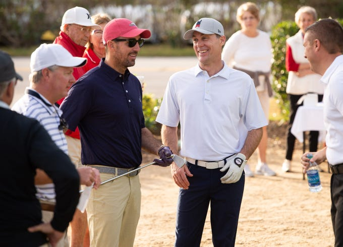 Country music star and Vero Beach native Jake Owen (left) shares a light moment with NASCAR driver Kevin Harvick during the first day of the Hale Groves Indian River Grapefruit Pro-am hosted by Jake Owen at the Vero Beach Country Club on Saturday, Dec. 8, 2018 in Vero Beach.
