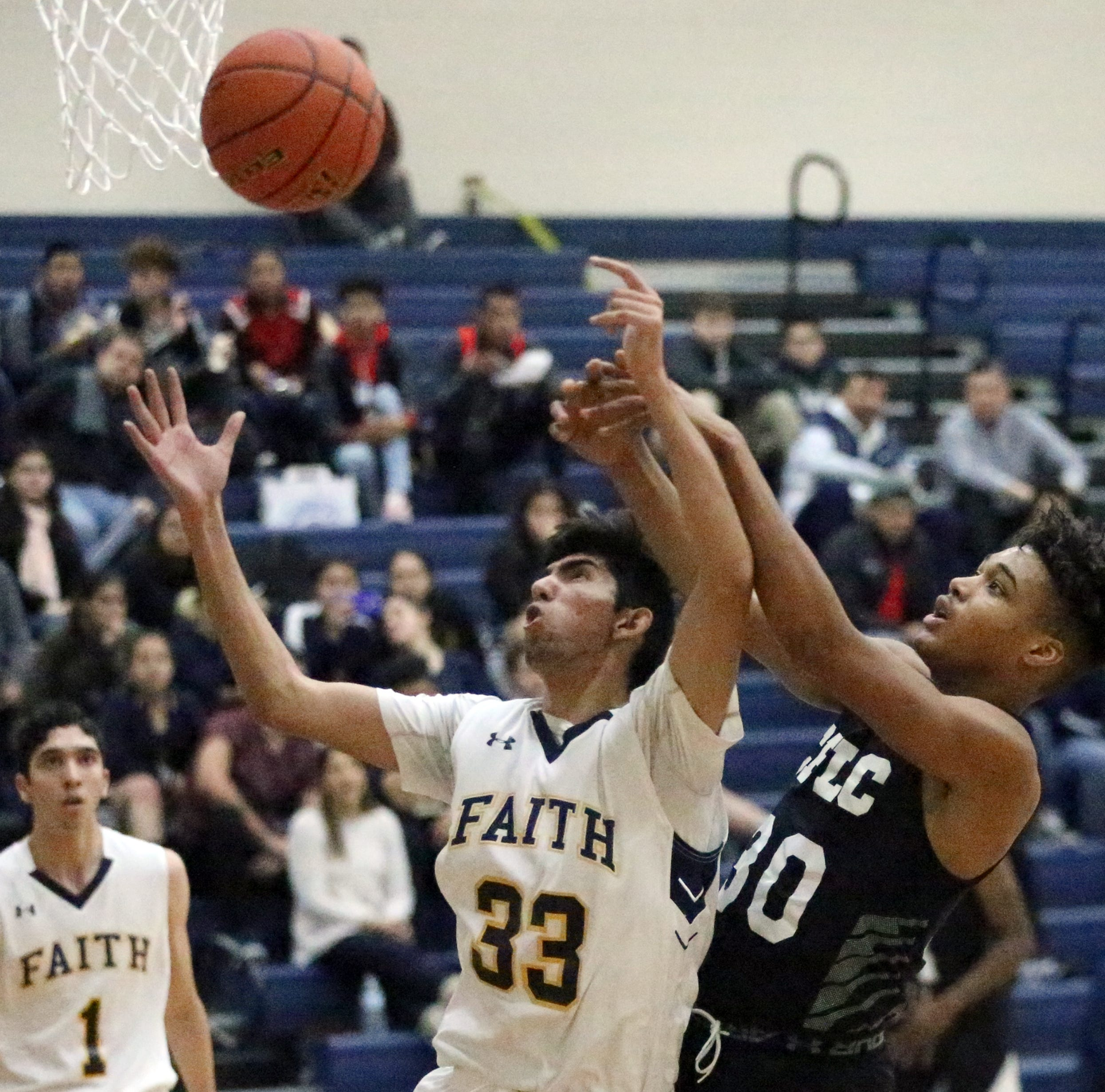 Luis Arroyo, 33, of Faith Christian Academy battles for a rebound with Kamari Smith, 30, of Cy Fair Learning Center Saturday at Del Valle High School.