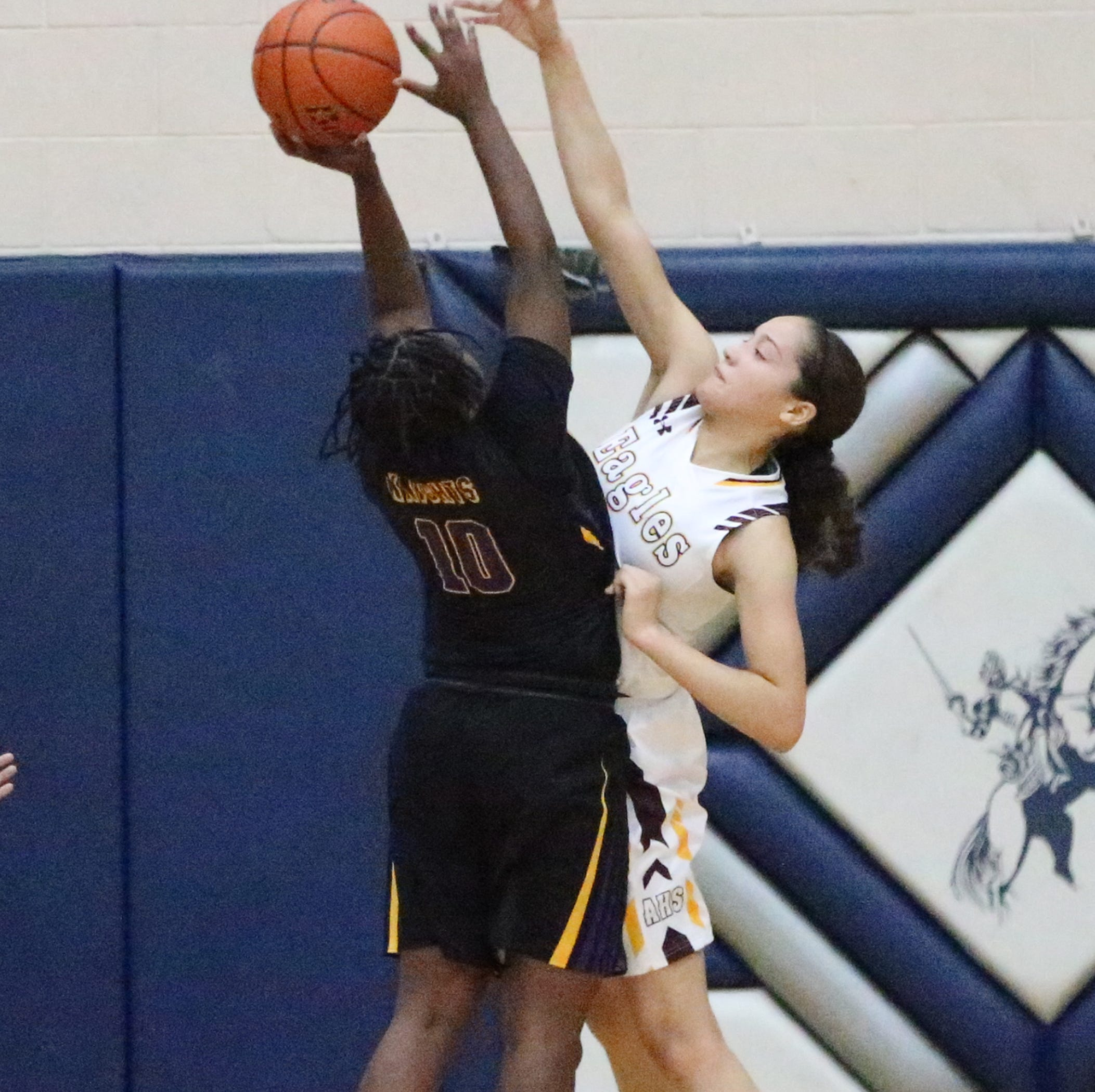 Players compete for the ball as Andress took on Lynwood in the girls final at the McDonald's Classic Basketball Tournament on Saturday at Del Valle High School.