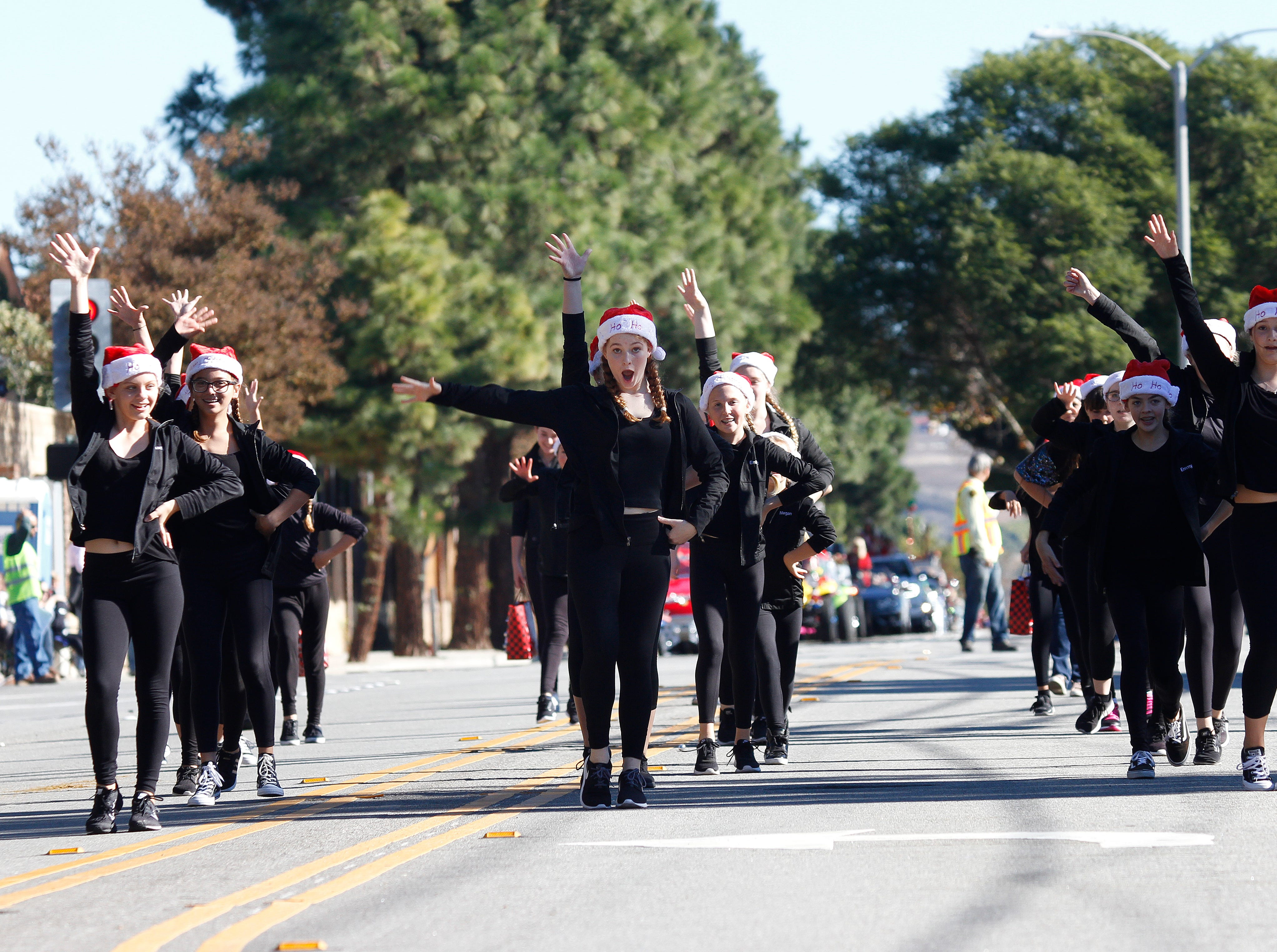 Members of The Dance Company perform in the Camarillo Christmas parade on Saturday.