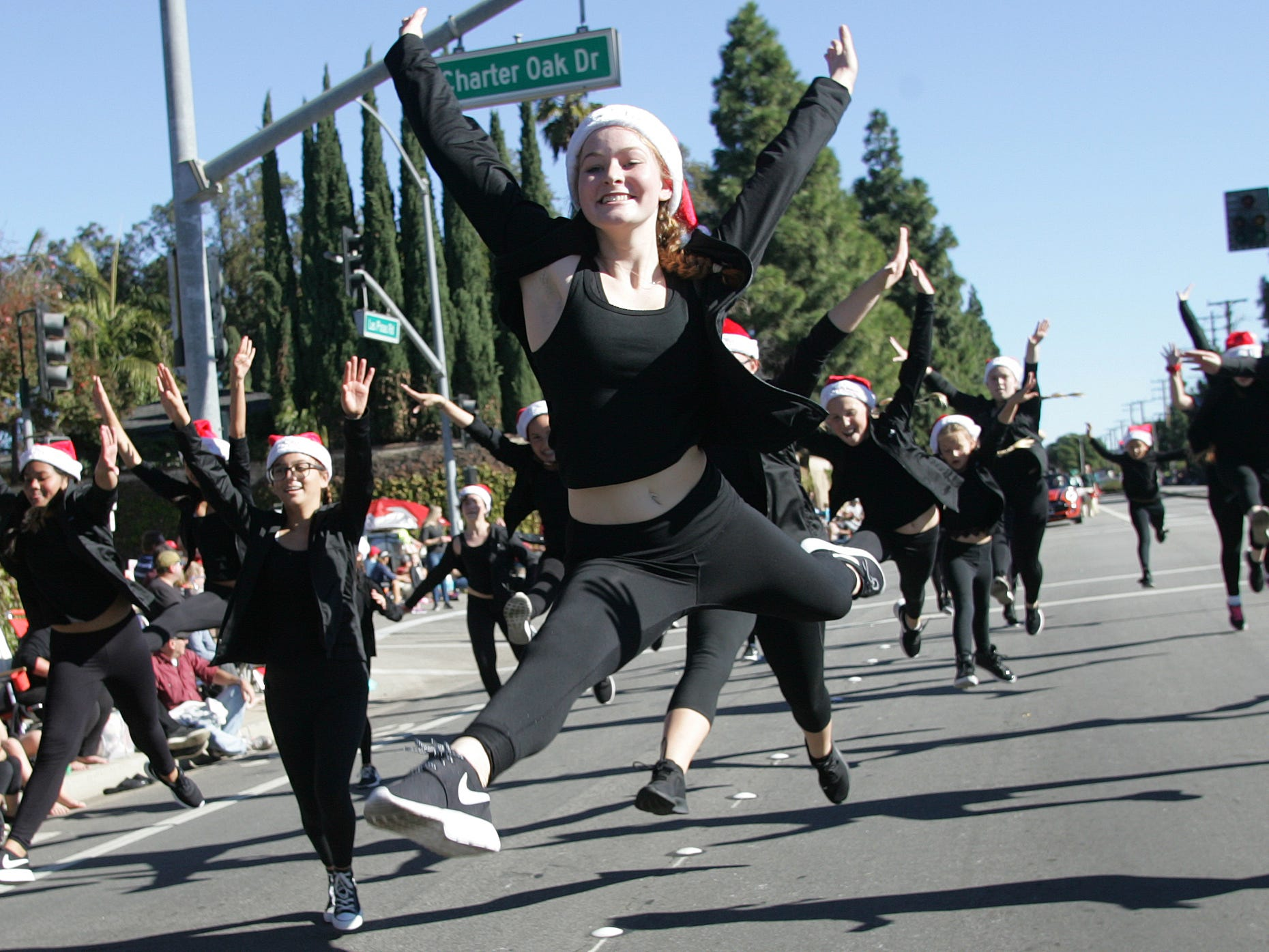 Chloe Leeds, center, from The Dance Company, performs in the Camarillo Christmas parade on Saturday.