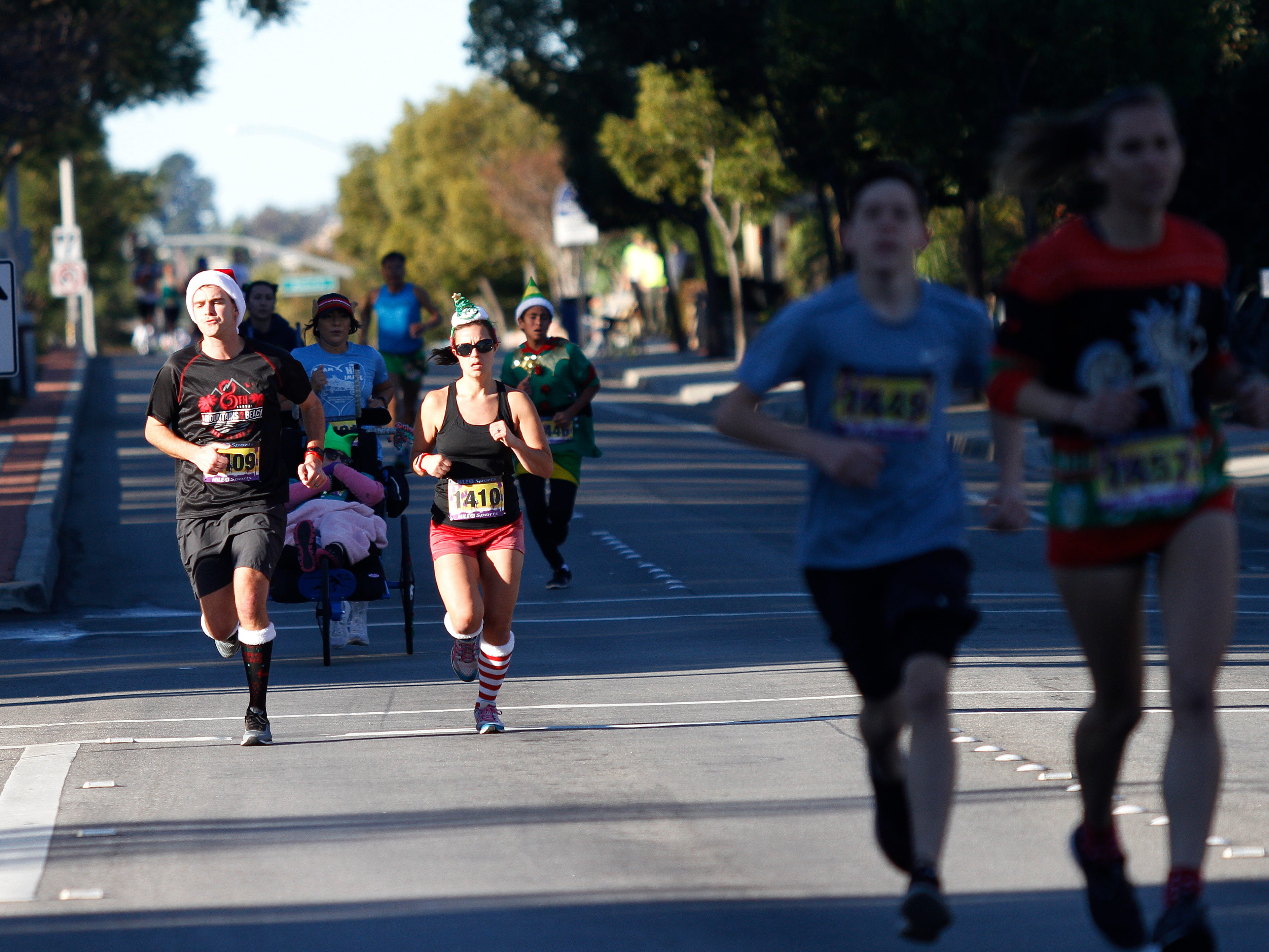 Brad and Rebecca Durant participate in the 5K run Saturday on Las Posas Road during Christmas festivities in Camarillo that included a parade and more.