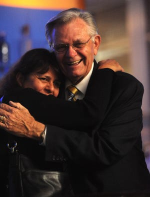 """Jim Monahan hugs his daughter at My Florist Cafe And Bakery where the Ventura City Council incumbent held his """"Win or Lose"""" election party in 2009."""