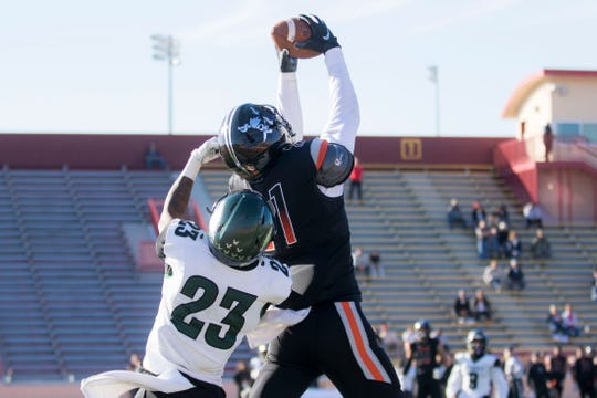 Ventura College sophomore Brandon Jordan rises over Laney College's Nahshon Wright to reel in a 29-yard touchdown pass Saturday afternoon at the CCCAA state championship game at Sacramento State's Hughes Stadium.