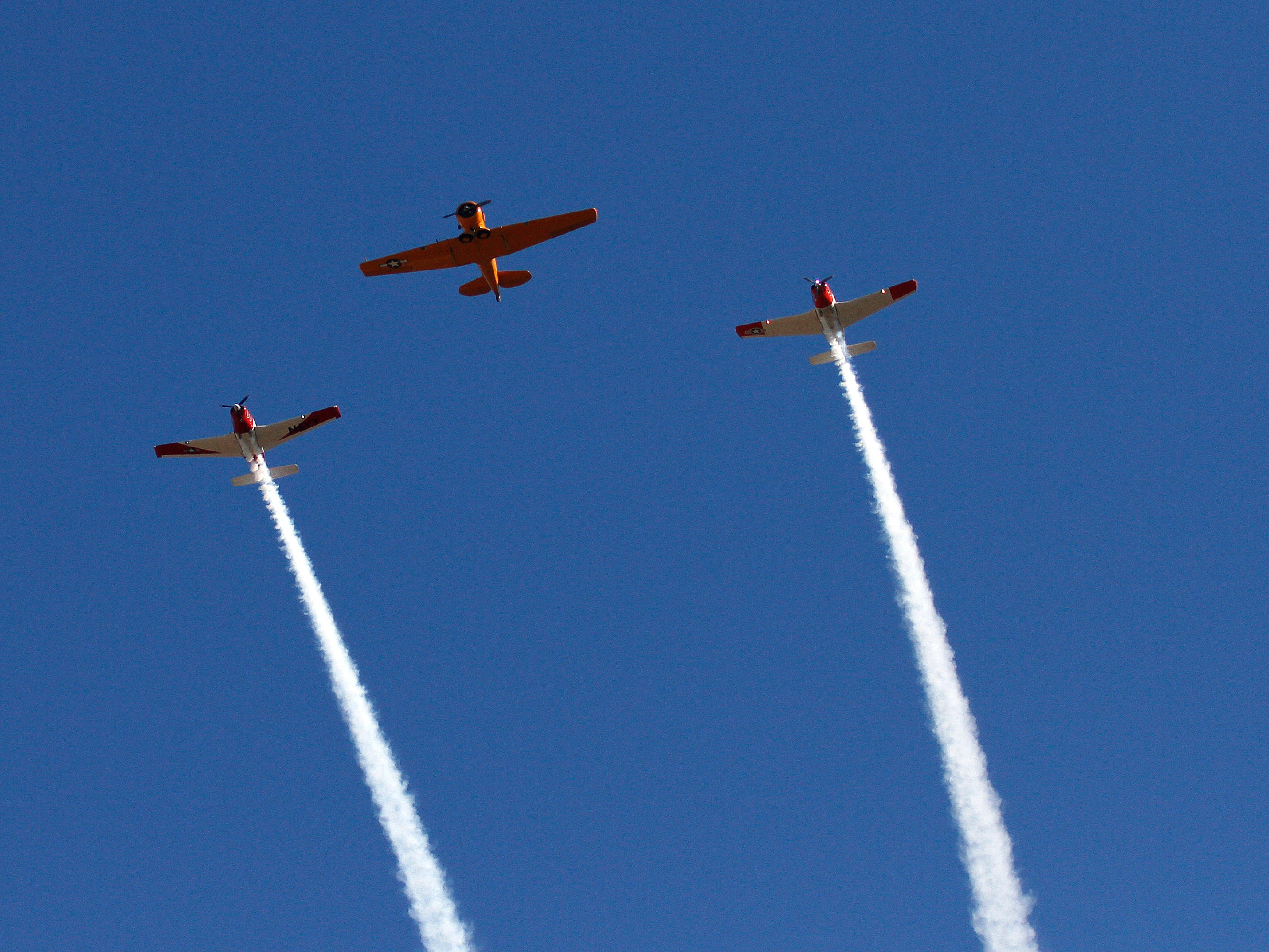 Airplanes fly in formation over the route to commemorate the beginning of the Camarillo Christmas parade on Saturday.