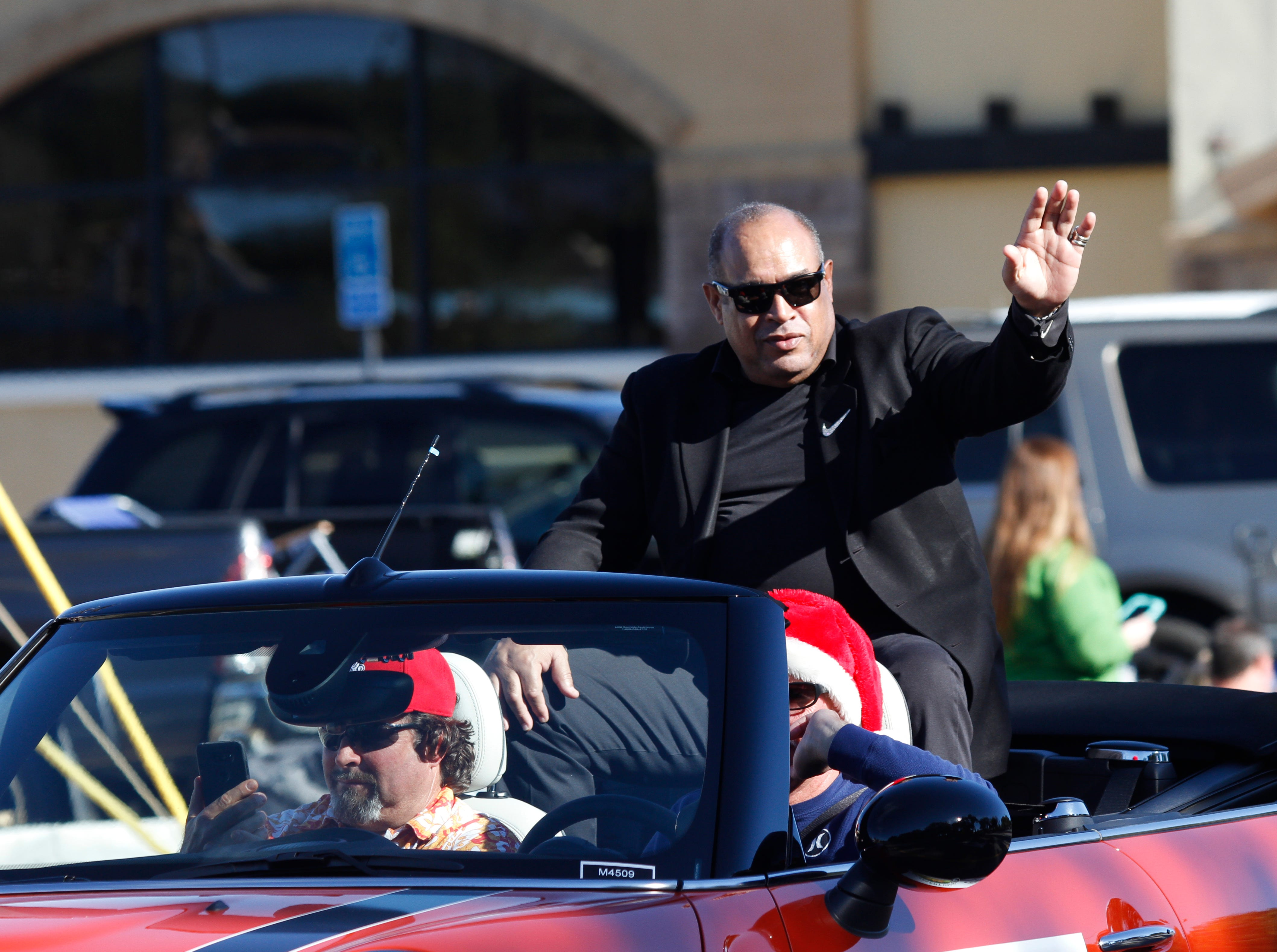 The grand marshal of the Camarillo Christmas parade, Anthony Davis, former USC star and NFL player, waves to the crowd on Saturday.