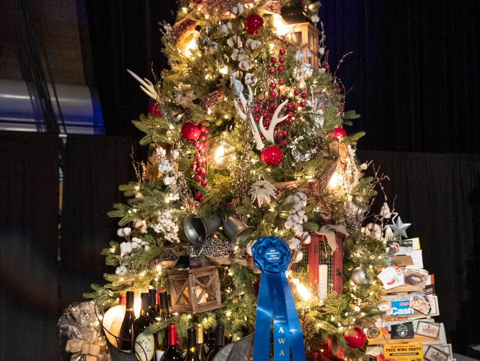 "Tree #11- Golden State Family Services. Visalia's 38th Annual Christmas Tree Auction on Friday, December 7, 2018. This year's theme was ""A Holiday Affair."" The live auctions alone generated nearly $60,000 in bids."