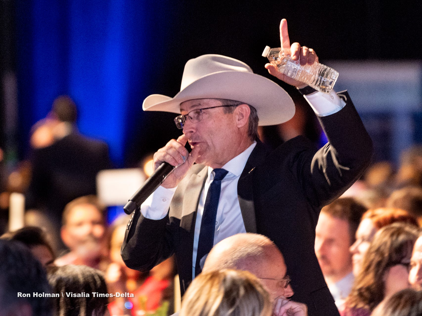 """Tulare County Sheriff Mike Boudreaux calls a tree auction during Visalia's 38th Annual Christmas Tree Auction on Friday, December 7, 2018. This year's theme was """"A Holiday Affair."""" The live auctions alone generated nearly $60,000 in bids."""