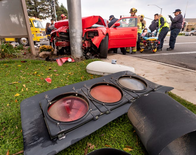 Four people were transported to KDMC after a collision between a northbound Cadillac and a westbound Dodge on Friday, December 7, 2018. Witnesses, according to police, said the Cadillac did not have the right-away. One traffic light and one street light fell from the pole that was hit after the collision.