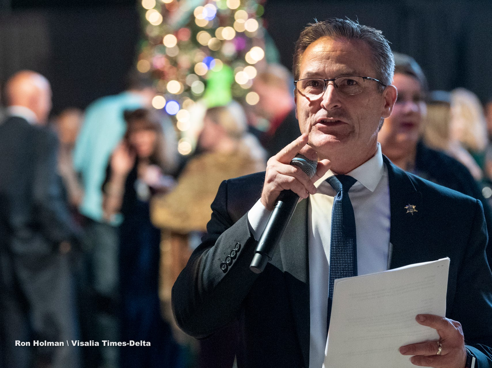 """Tulare County Sheriff Mike Boudreaux starts the bidding for Visalia's 38th Annual Christmas Tree Auction on Friday, December 7, 2018. This year's theme was """"A Holiday Affair."""" The live auctions alone generated nearly $60,000 in bids."""