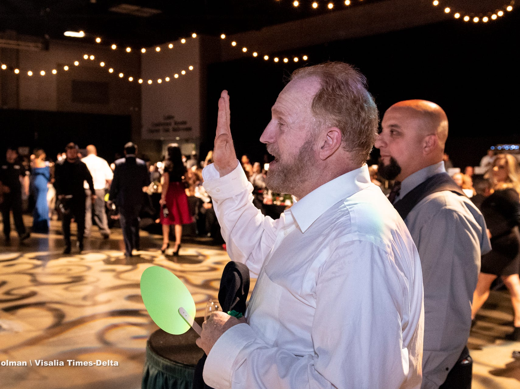 """A $5,000 bid is offered during Visalia's 38th Annual Christmas Tree Auction on Friday, December 7, 2018. This year's theme was """"A Holiday Affair."""" The live auctions alone generated nearly $60,000 in bids."""