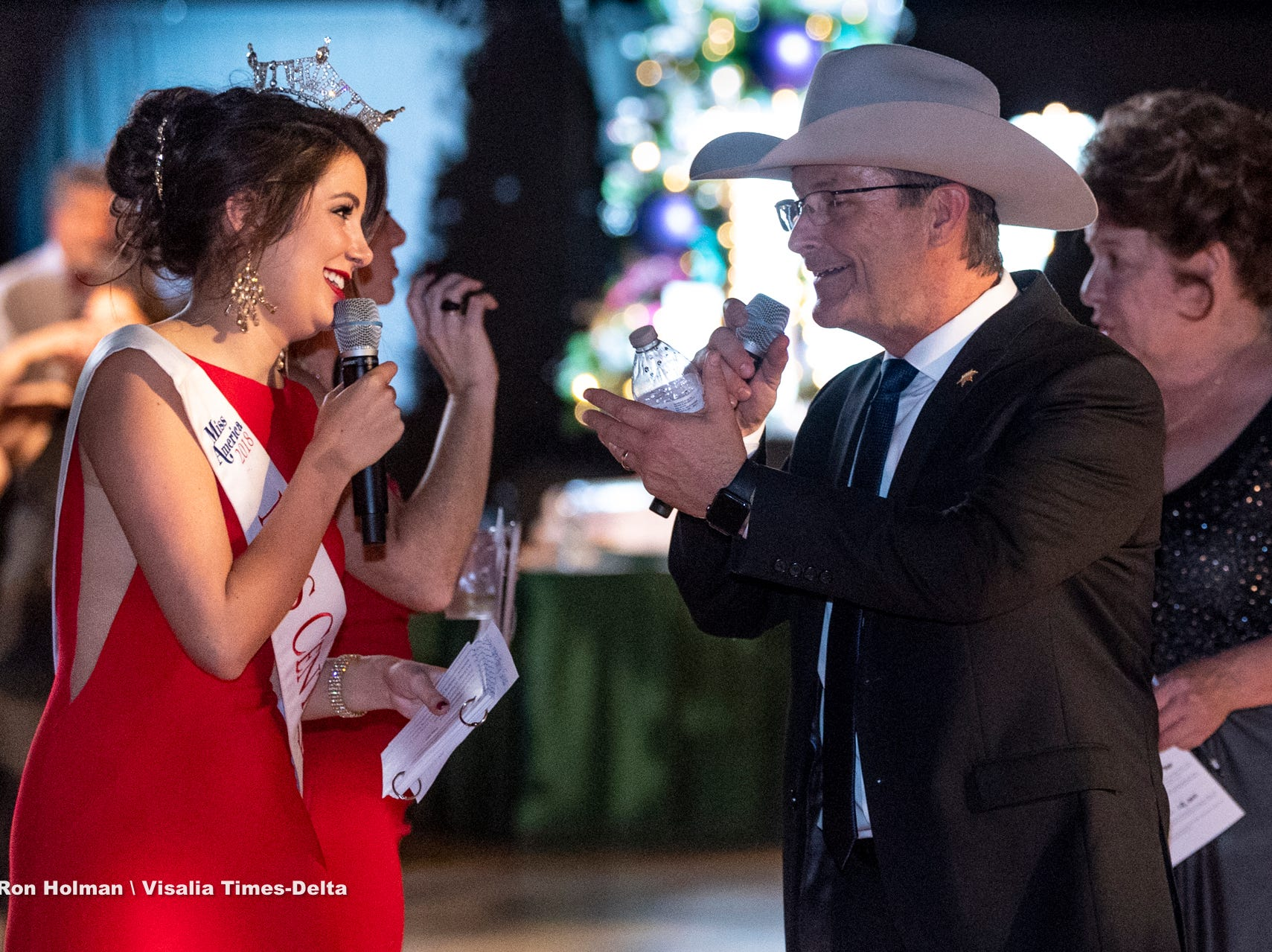 "Miss Central Valley Alexandra Macedo, left, and Tulare County Sheriff Mike Boudreaux teased each other often during Visalia's 38th Annual Christmas Tree Auction on Friday, December 7, 2018. This year's theme was ""A Holiday Affair."" The live auctions alone generated nearly $60,000 in bids."