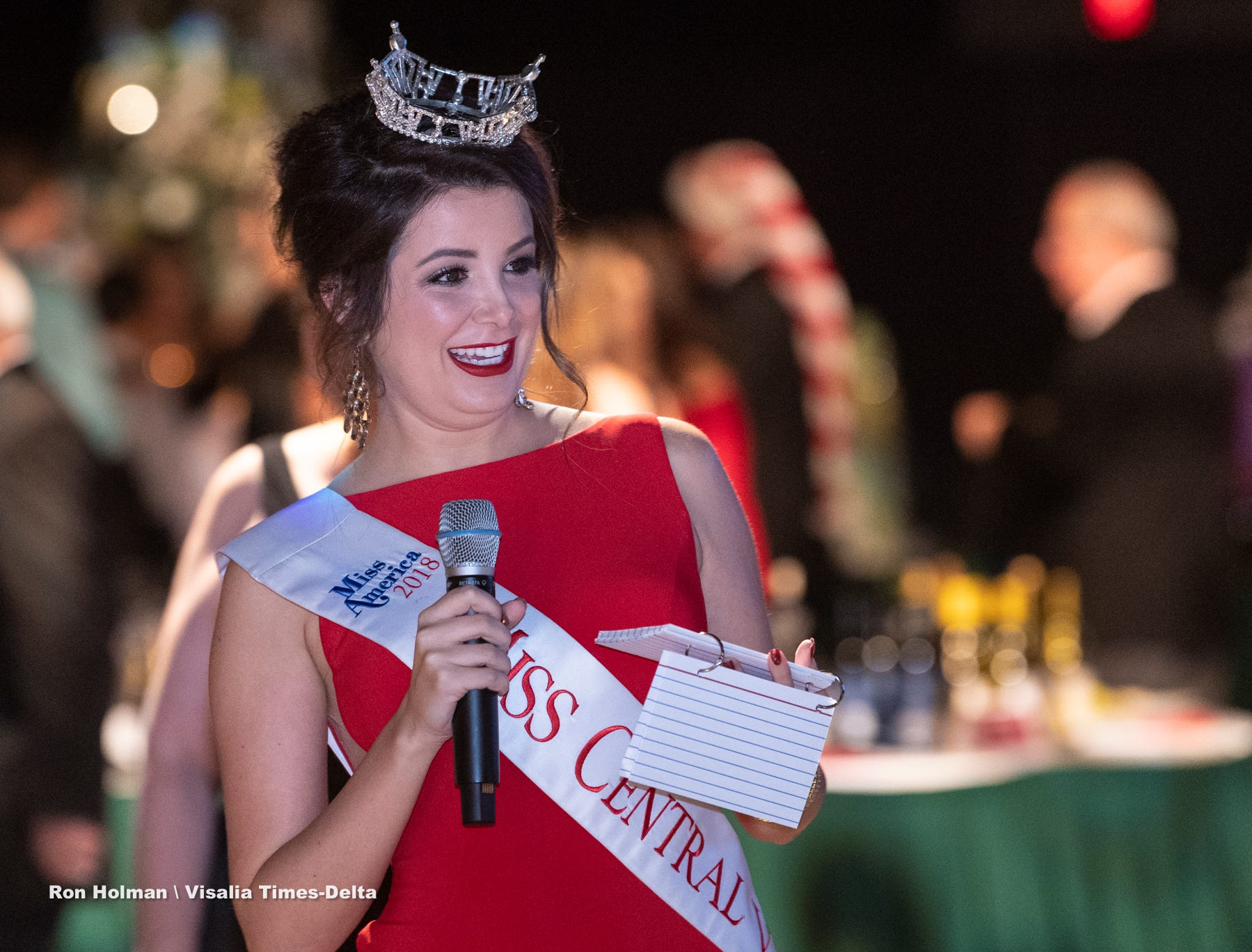 "Miss Central Valley Alexandra Macedo reacts to Tulare County Sheriff Mike Boudreaux's comments during Visalia's 38th Annual Christmas Tree Auction on Friday, December 7, 2018. This year's theme was ""A Holiday Affair."" The live auctions alone generated nearly $60,000 in bids."