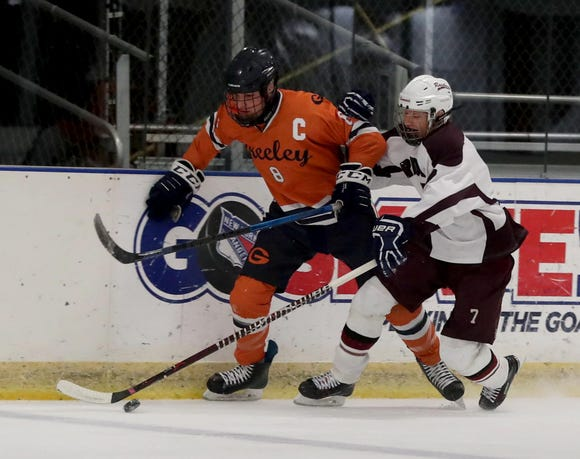 Liam Whitehouse of Horace Greeley and David Umansky of Scarsdale battle  Friday at the EJ Murray Skating Center in Yonkers. Greeley won, 2-1.