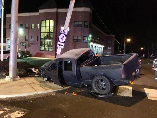 Newport police and other agencies closed part of Del. 141 in Newport Saturday night to clear the area of a pickup that crashed.