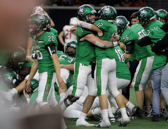 Iowa Park's Trent Green, left, and Reid Lalk celebrates with their 31-28 win over Glen Rose Friday, Dec. 7, 2018, at the Ford Center in Frisco.