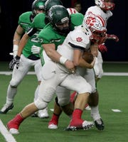 Iowa Park's Jeremiah Stanley tackles Glen Rose's Westen Halcom Friday, Dec. 7, 2018, at the Ford Center in Frisco. The Hawks defeated the Tigers 31-28.