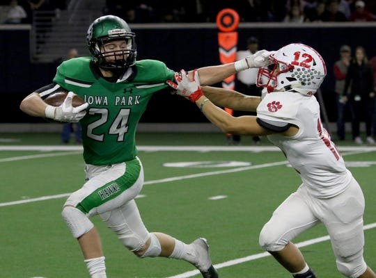 Iowa Park's Kaden Ashlock stiff arms Glen Rose's Samuel McPherson Friday, Dec. 7, 2018, at the Ford Center in Frisco. The Hawks defeated the Tigers 31-28.