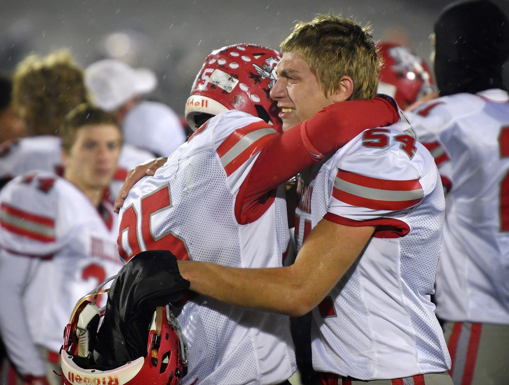 Nathan Sheen (85) and John Paul Menasco (54) console each other after the Holliday Eagles lost to the Gunter Tigers in the state quarterfinal game Friday night in Denison. Gunter won, 27-6.