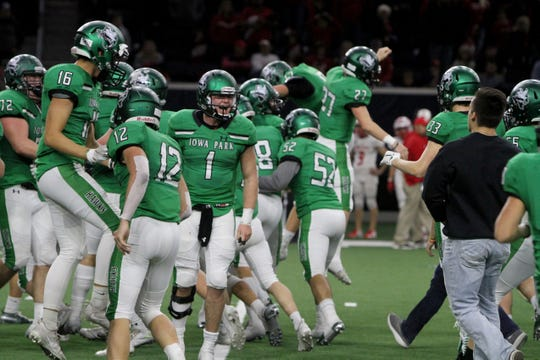 Iowa Park celebrates their 31-28 win over Glen Rose Friday, Dec. 7, 2018, at the Ford Center in Frisco.