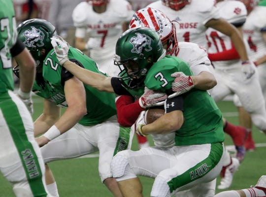 Iowa Park's Slayton Ochoa is tackled by a Glen Rose defender Friday, Dec. 7, 2018, at the Ford Center in Frisco. The Hawks defeated the Tigers 31-28.