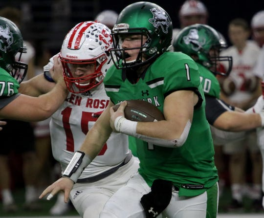 Iowa Park's Trent Green runs thorugh the line of scrimmage against Glen Rose Friday, Dec. 7, 2018, at the Ford Center in Frisco. The Hawks defeated the Tigers 31-28.