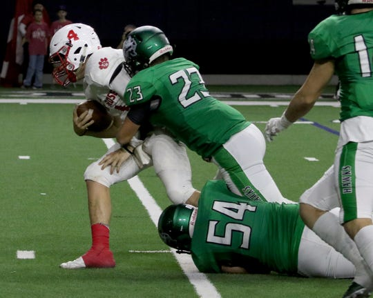Iowa Park's Zane Petering (23) and Ryder Roberts (54) tackles Glen Rose's Cameron Griffin Friday, Dec. 7, 2018, at the Ford Center in Frisco. The Hawks defeated the Tigers 31-28.