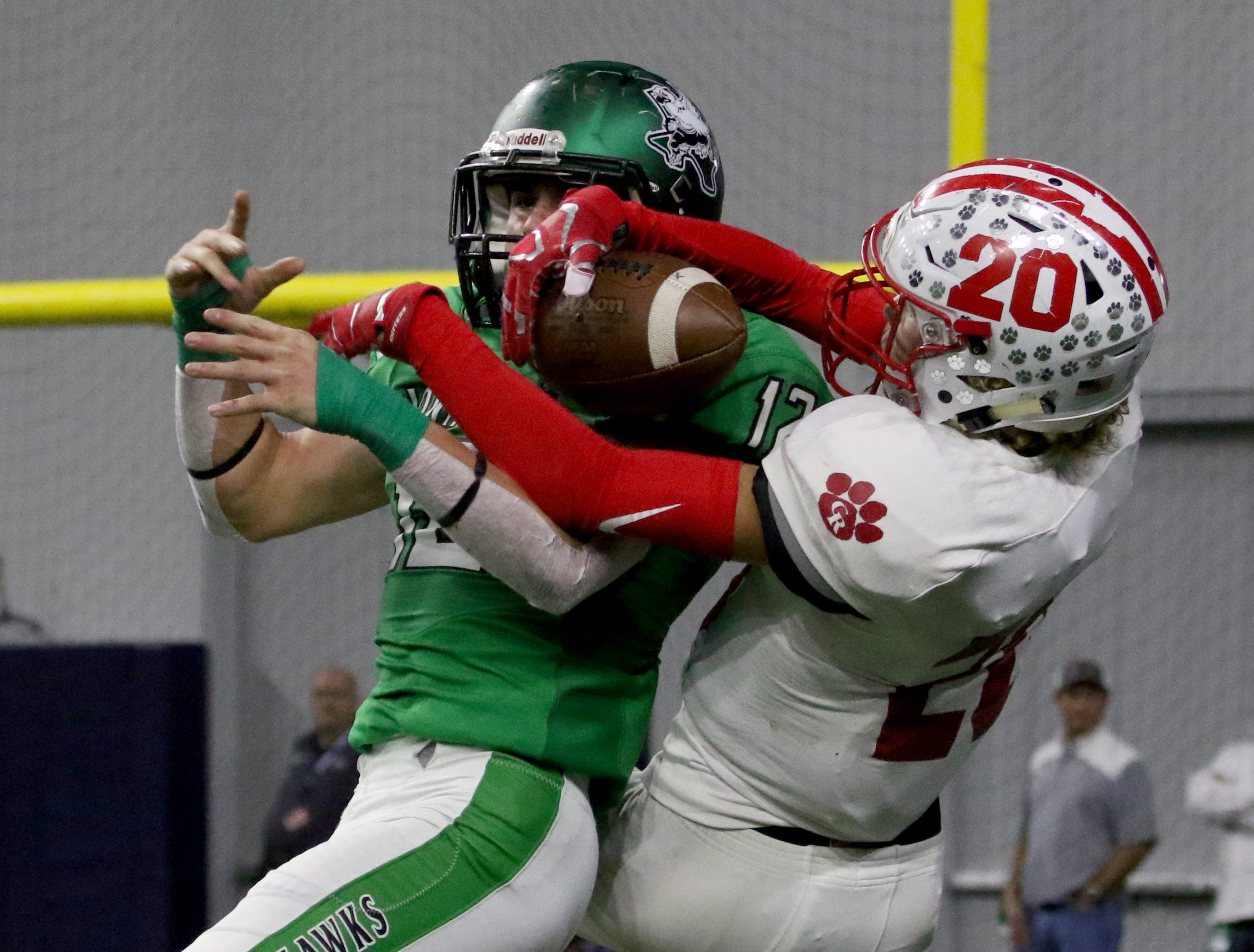 Glen Rose's Teddy Starnes makes the catch over Iowa Park's Reid Lalk Friday, Dec. 7, 2018, at the Ford Center in Frisco. The Hawks defeated the Tigers 31-28.