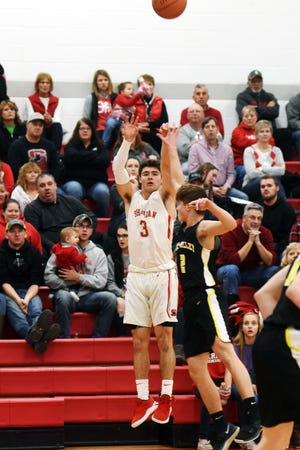 Ethan Heller shoots a 3-pointer during the first half of Sheridan's 65-46 win against Tri-Valley on Friday night at Glen Hursey Gymnasium. Heller hit six 3-pointers among his game-high 25 points.