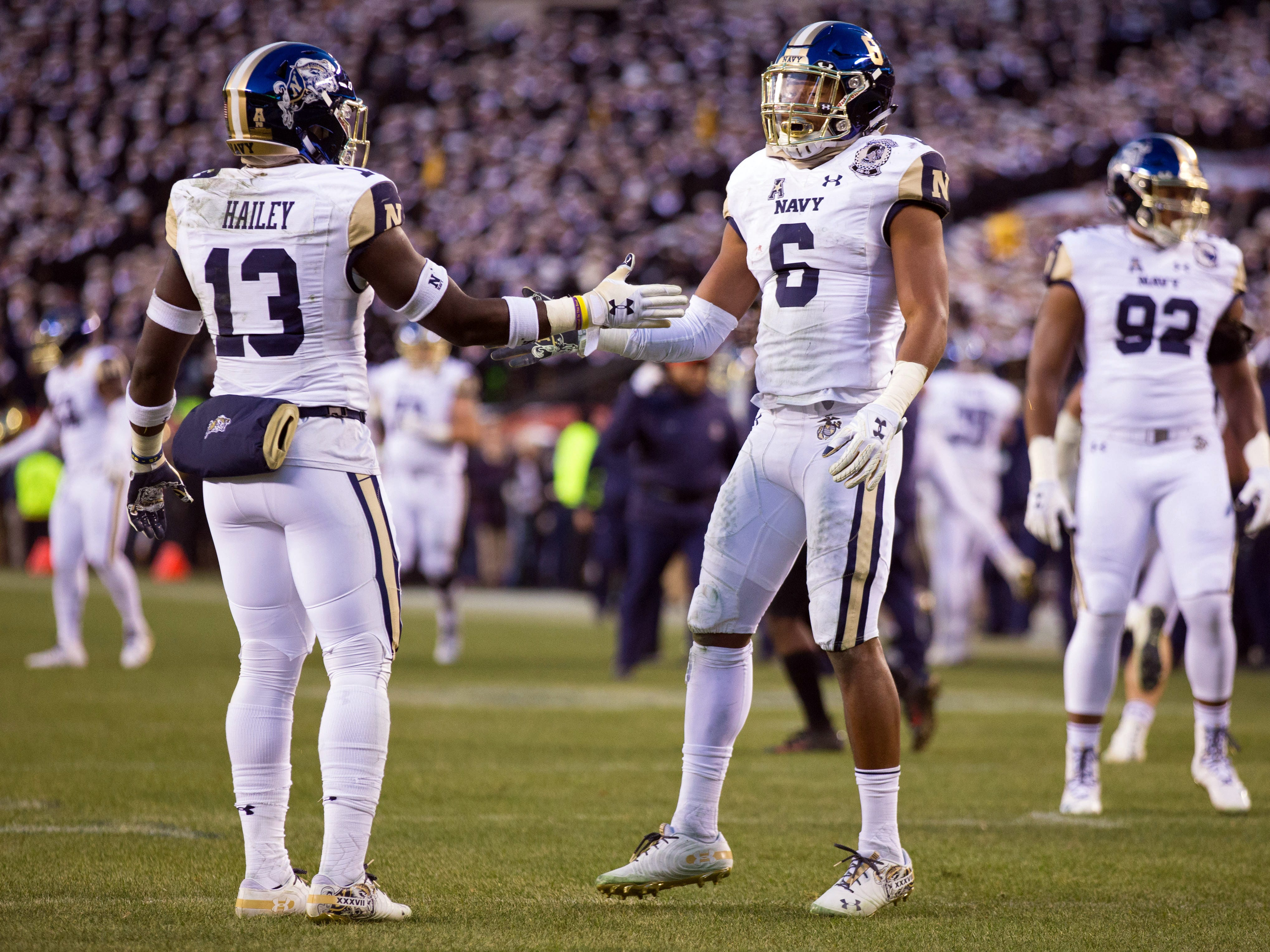 Navy Midshipmen safety Juan Hailey and safety Sean Williams react after a defensive stop during the second quarter.