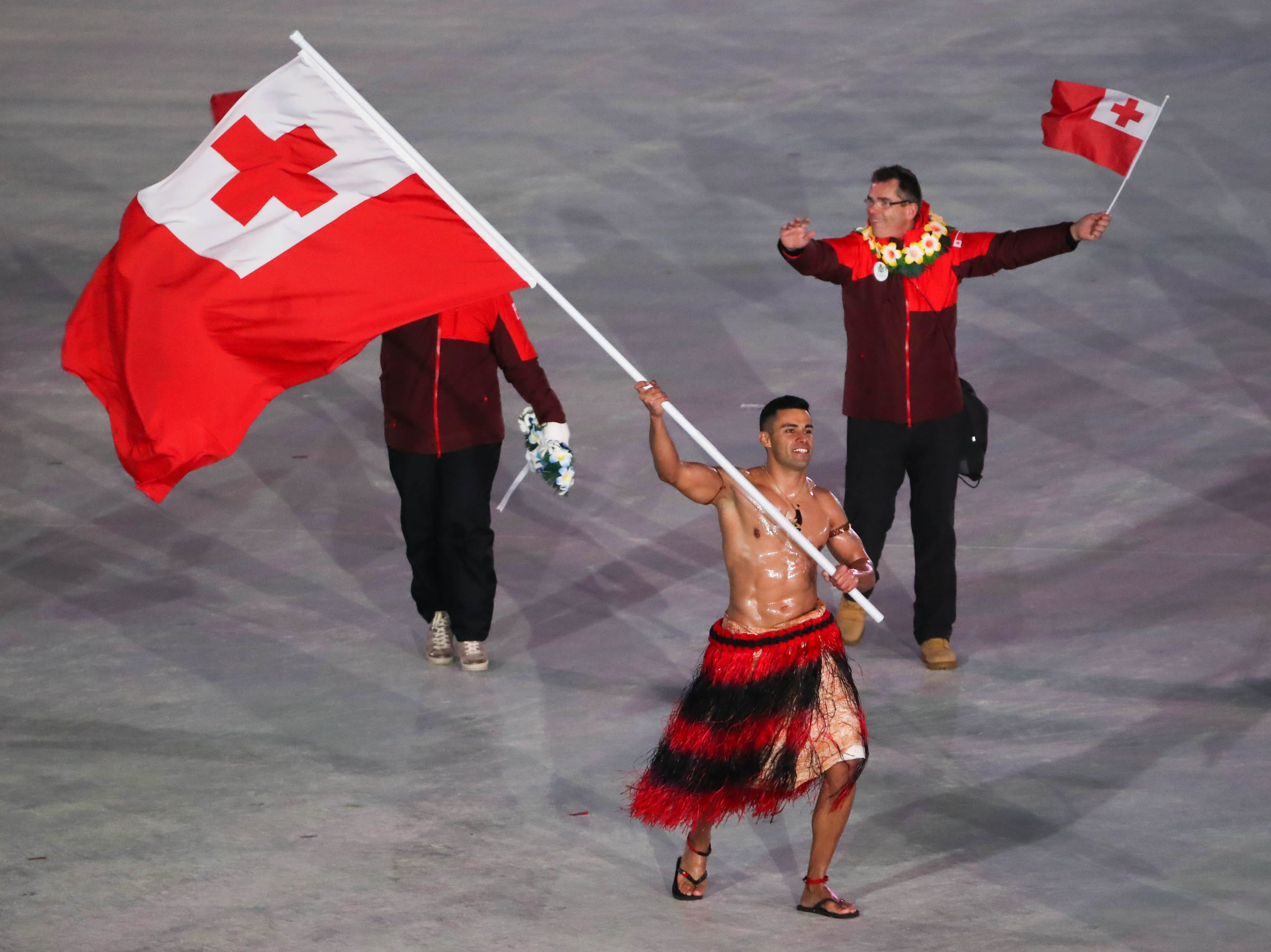 Feb. 9: Pita Taufatofua of Tonga arrives in the parade of athletes in the opening ceremony for the Pyeongchang Winter Games.