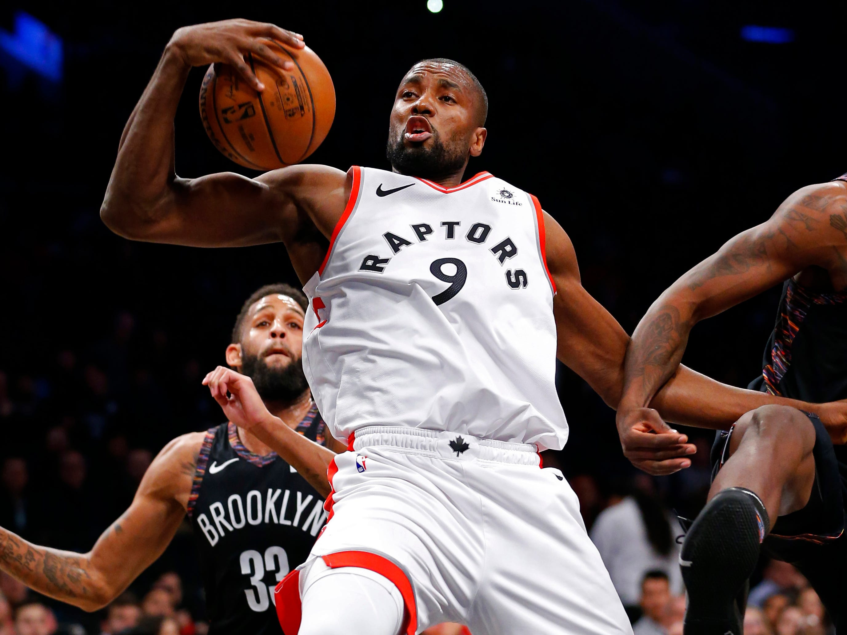 Dec. 7: Raptors forward Serge Ibaka pulls down a one-handed rebound during the first half against the Nets in Brooklyn.