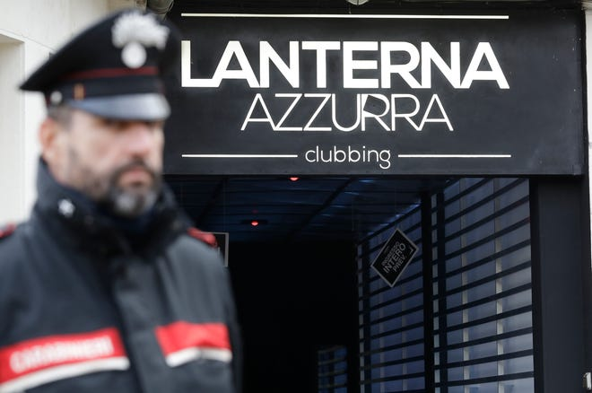 A Carabiniere officer stands in front of the disco 'Lanterna Azzurra' in Corinaldo, central Italy, Saturday, Dec. 8, 2018. At least Six people, all but one of them minors, were killed and about 35 others injured in a stampede of panicked concertgoers early Saturday at a disco in a small town on Italy's central Adriatic coast.