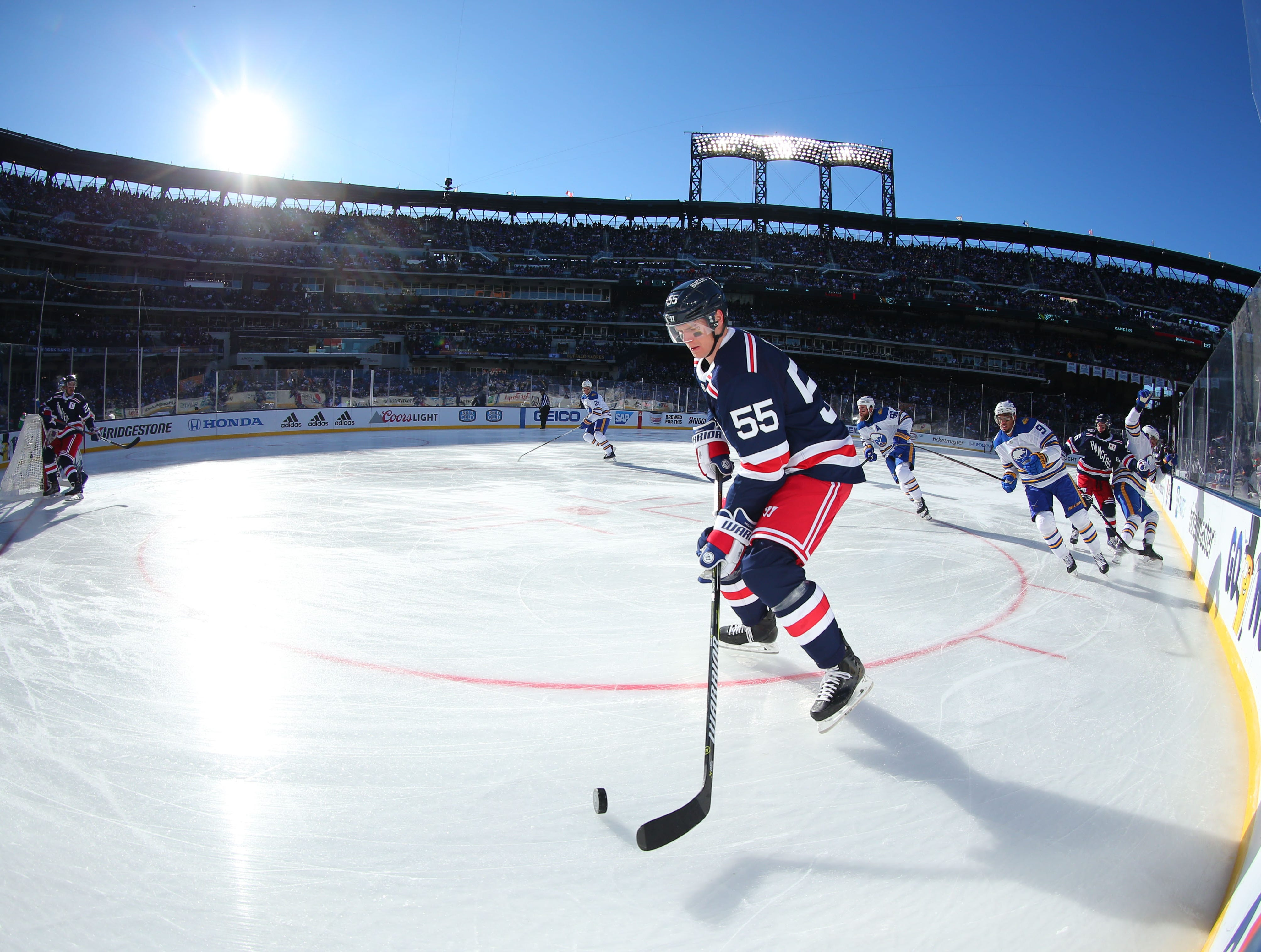 Jan. 1: New York Rangers defenseman Nick Holden skates with the puck against the Buffalo Sabres in the first period in the 2018 Winter Classic hockey game at Citi Field.