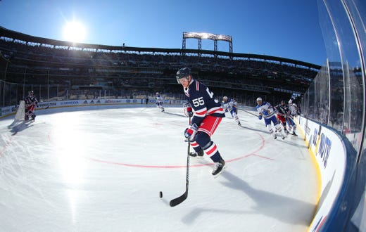 Jan. 1  New York Rangers defenseman Nick Holden skates with the puck  against the 01b394e2a
