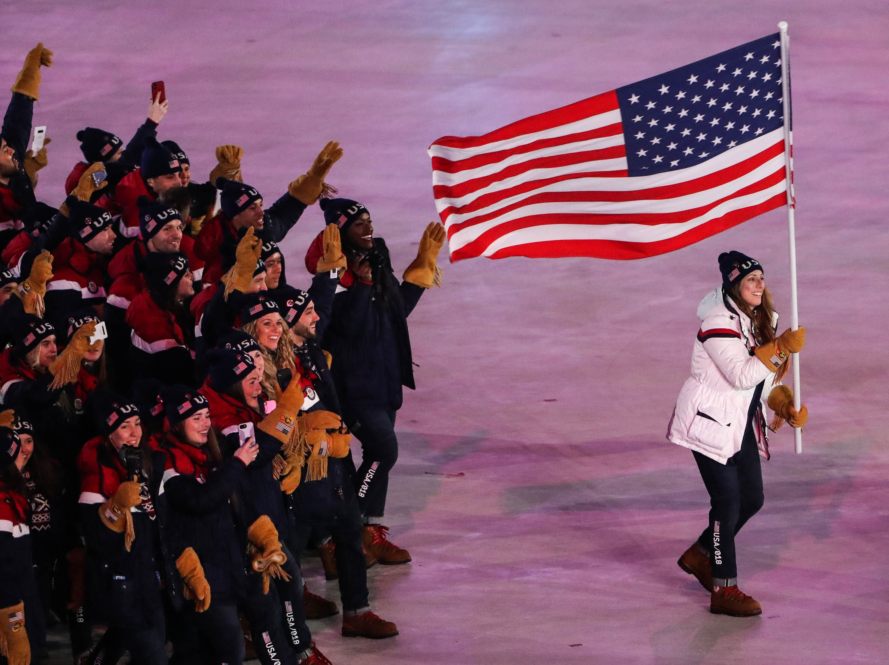 Feb. 9: Erin Hamlin leads Team USA in the parade of athletes in the opening ceremony during the Pyeongchang Winter Games.
