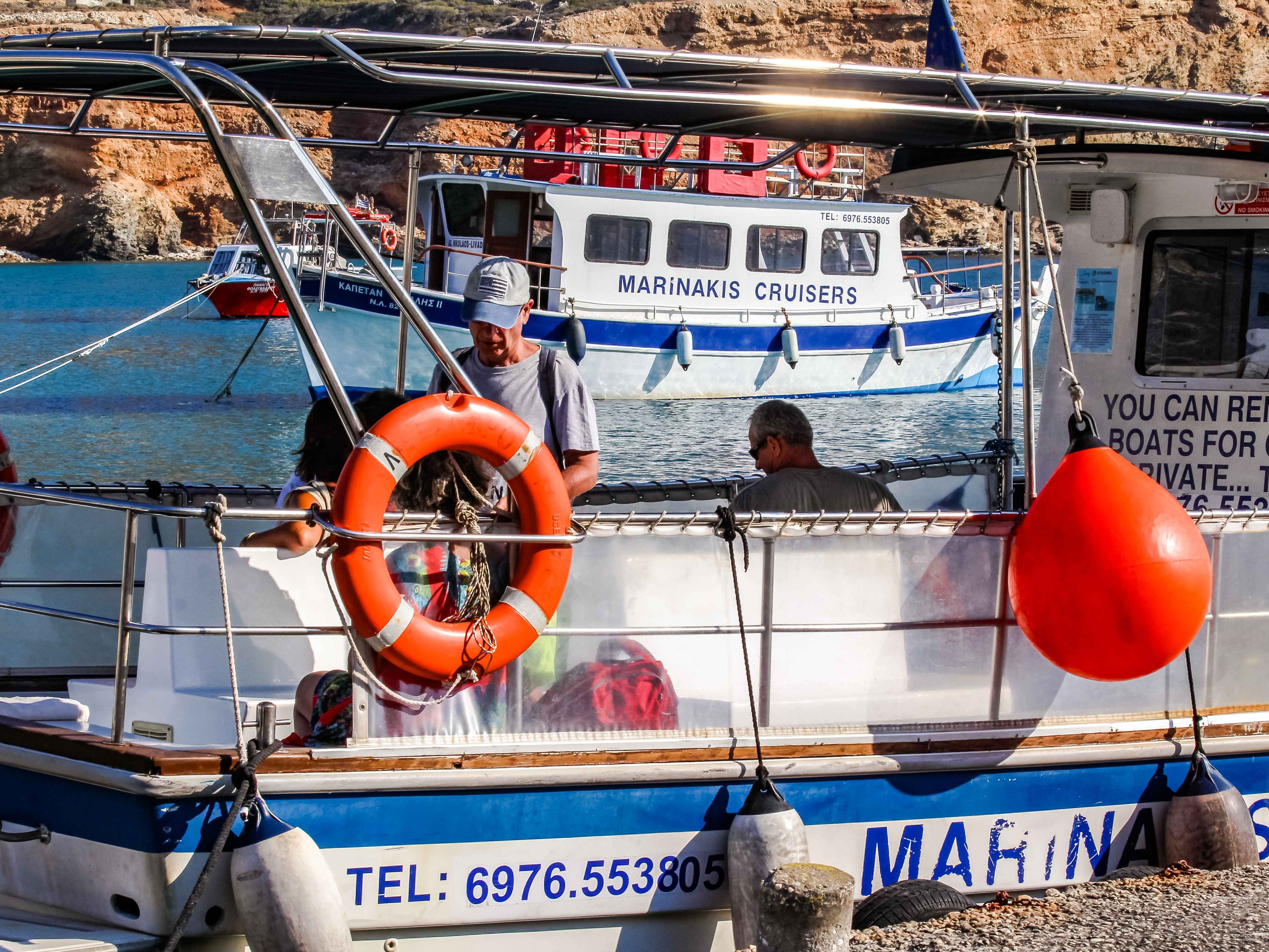 Small boats transport visitors around the steep and rocky island and also provide tours and fishing trips.