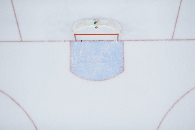 A general view of an empty hockey net.