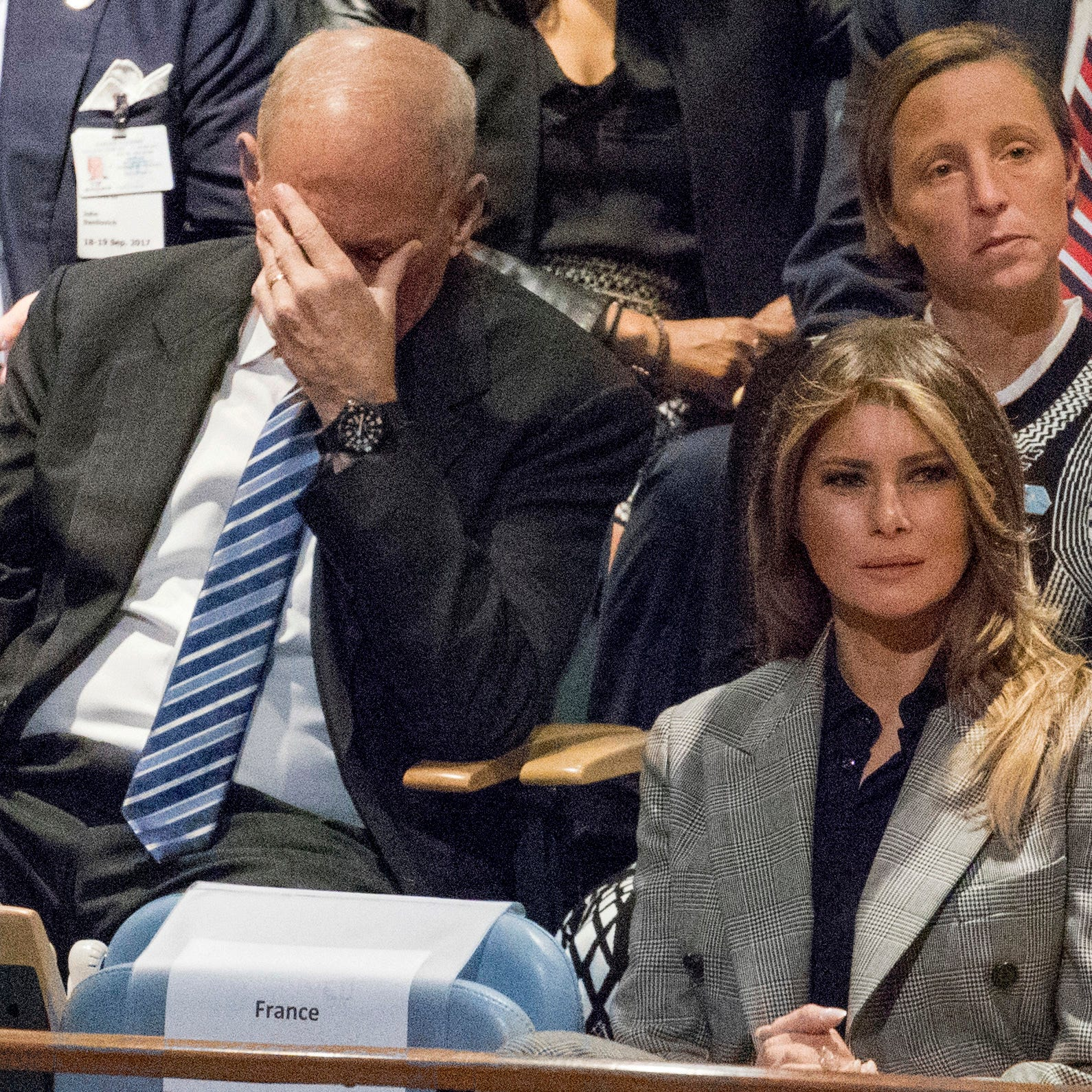 White House Chief of Staff John Kelly, left, reacts as he and first lady Melania Trump listen to U.S. President Donald Trump speak during at the United Nations General Assembly at U.N. headquarters in Sept. 2017.