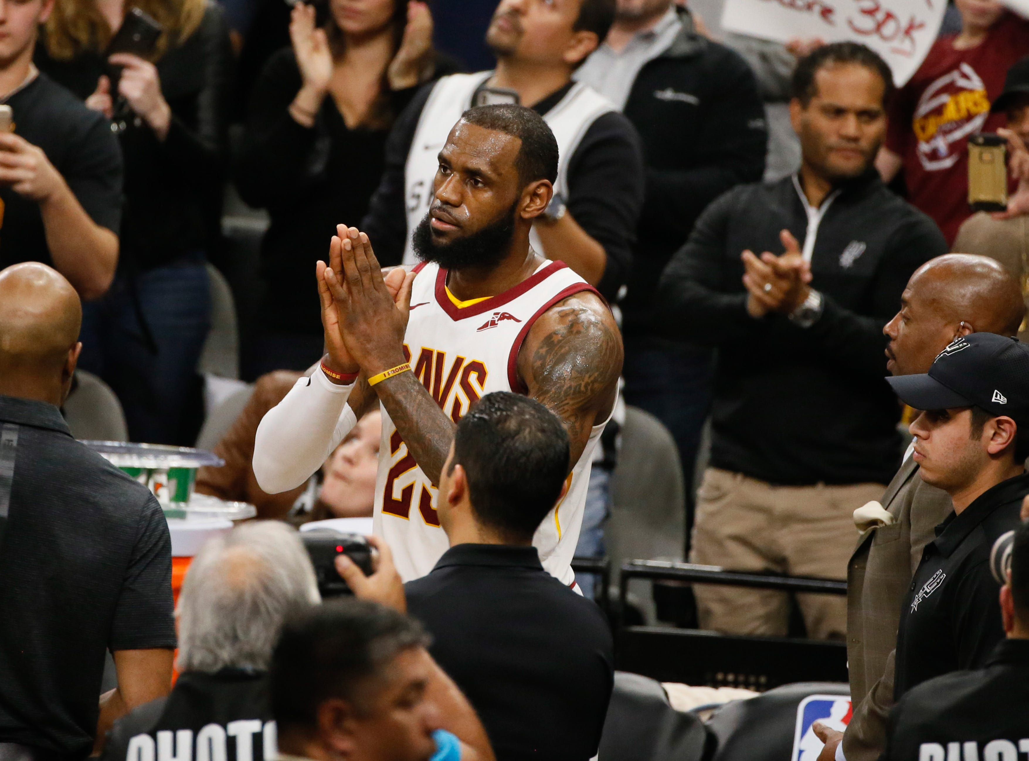 Jan. 23: Cleveland Cavaliers forward LeBron James salutes the crowd after scoring his 30,000th career point during a game against the San Antonio Spurs.