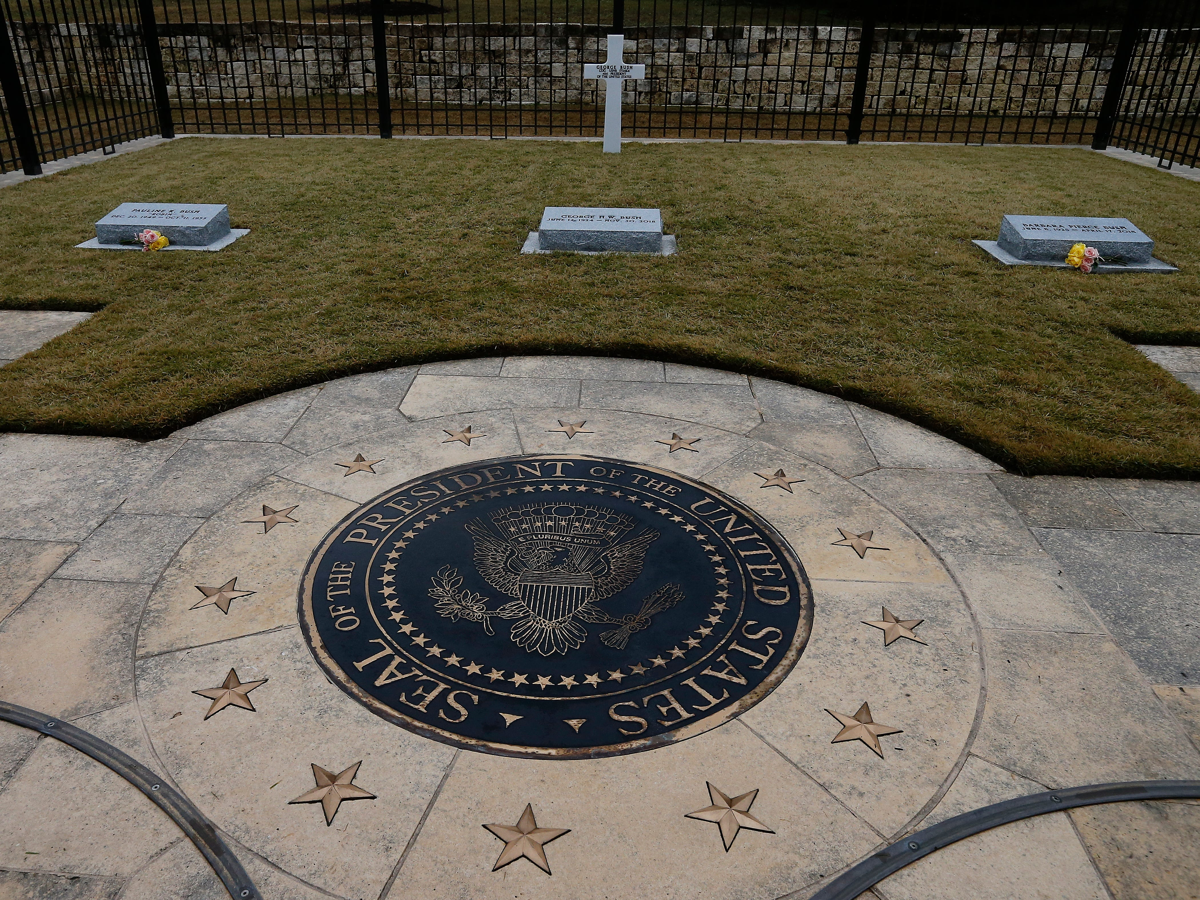 The gravesite of former US President George H.W. Bush, center, his wife Barbara Bush , right, and their daughter Robin at the Presidential Library and Museum in College Station, Texas on Dec. 8, 2018.