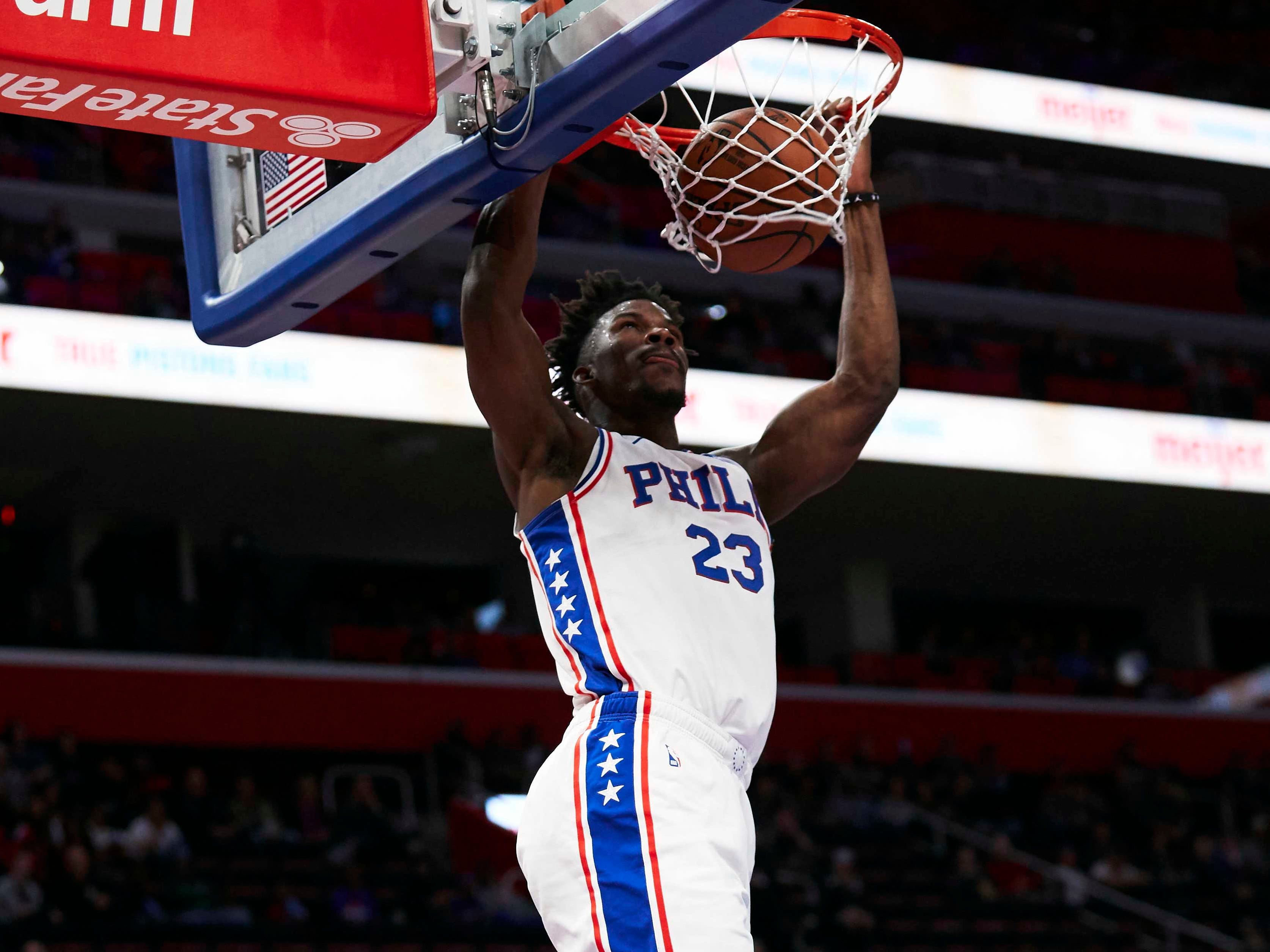 Dec. 7: 76ers guard Jimmy Butler throws down the two-handed finish during the first half against the Pistons in Detroit.