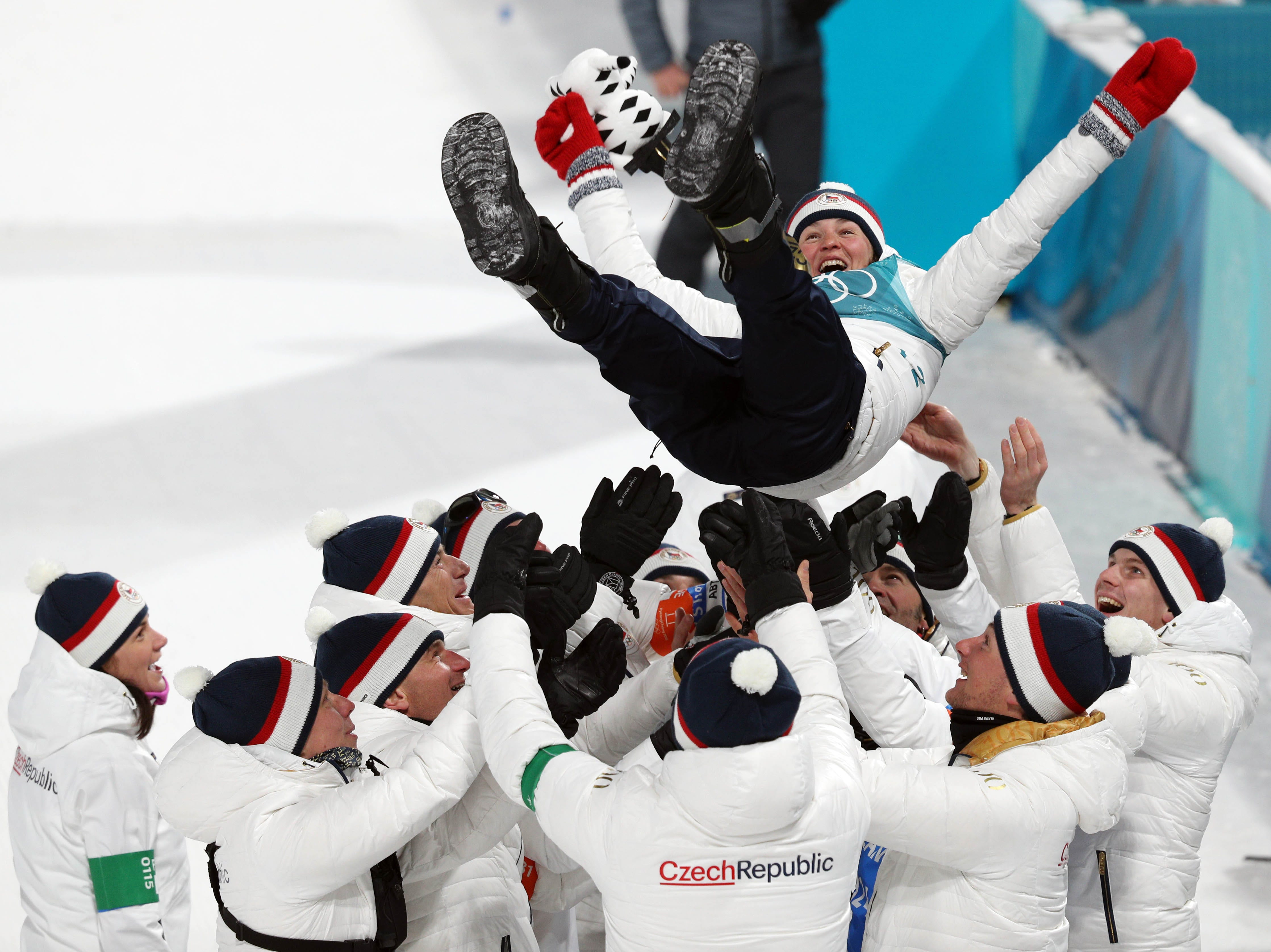 Feb. 10: Veronika Vitkova (CZE) celebrates with her team after winning the bronze medal in the women's biathlon 7.5km sprint at the Pyeongchang Winter Games.