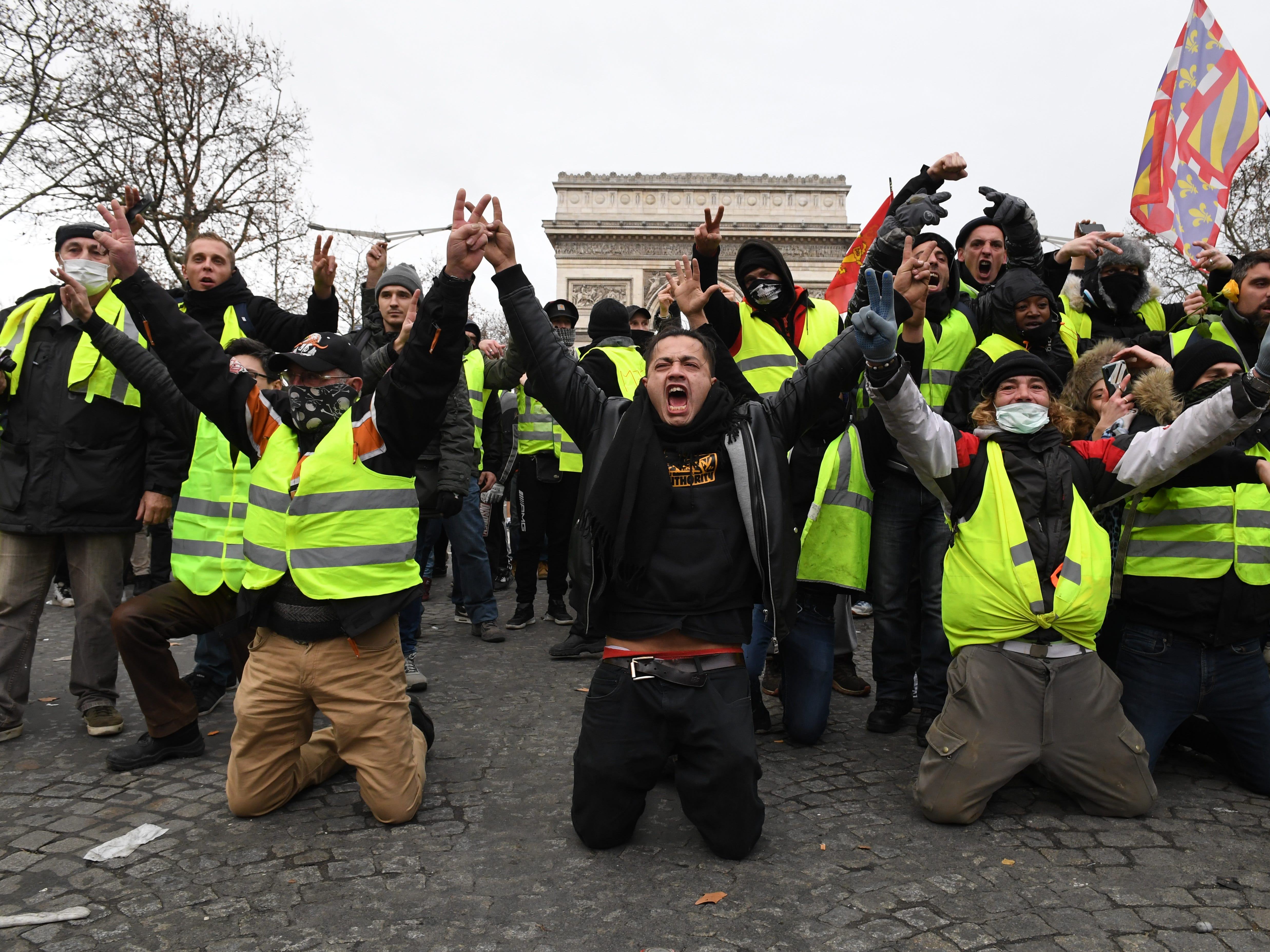 Scuffles, tear gas as police clamp down on Paris yellow vest protest